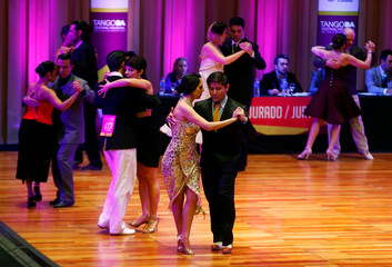 Couples compete in the Salon Tango style qualifier round at the Tango World Championship in Buenos Aires