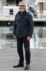 "Actor Tcheky Karyo poses during a photocall for the television series ""The Missing, Series 2"" during the annual MIPCOM television programme market in Cannes"