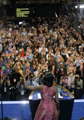 U.S. first lady Obama acknowledges delegates while addressing the first session of the Democratic National Convention in Charlotte