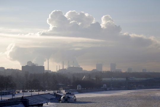 A general view shows the ice-covered Moskva River with a heating power plant seen in the background on a frosty winter day in Moscow