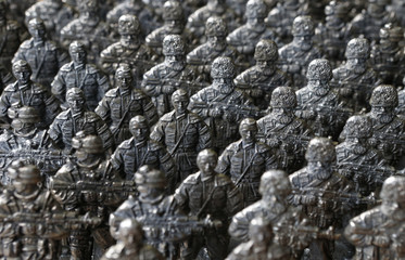 Figurines from the collection entitled 'Toy soldiers of Novorossiya' are on display at a workshop in Moscow