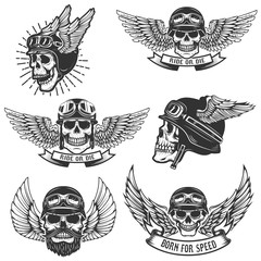 Set of skulls in winged motorcycle helmets. Design elements for logo, label, emblem, sign, badge. Vector illustration