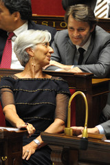 France's Finance Minister Lagarde speaks with Budget, Civil Service and Government Minister Baroin at the National Assembly in Paris