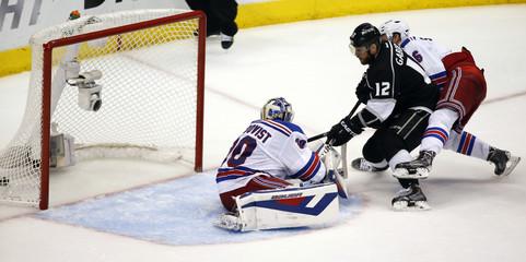 Los Angeles Kings' Gaborik scores on New York Rangers' goalie Lundqvist during NHL Stanley Cup Finals in Los Angeles