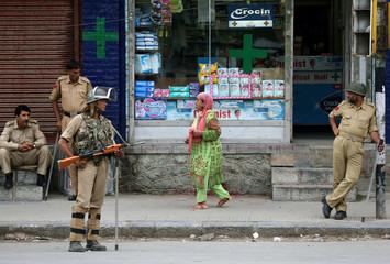 A woman leaves a chemist shop in Srinagar