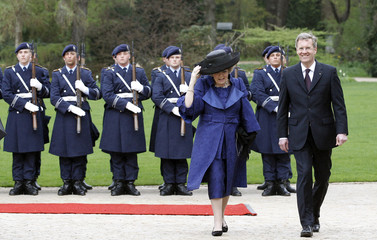 German President Wulff and Netherlands' Queen Beatrix inspect guard of honour at presidential Bellevue palace in Berlin