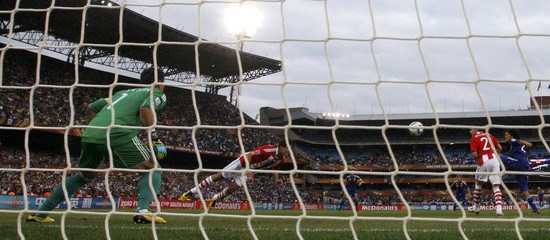 Paraguay's Santa Cruz clears the ball during a 2010 World Cup second round soccer match against Japan in Pretoria