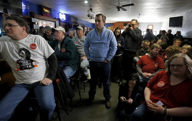 U.S. Republican presidential candidate Ted Cruz listens to his introduction at a campaign event in Ringsted