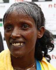 Kebede of Ethopia celebrates after winning the women's 37th Berlin Marathon in Berlin