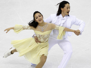 Yu and Wang of China perform during the ice dance compulsory dance event at the World Figure Skating Championships in Turin