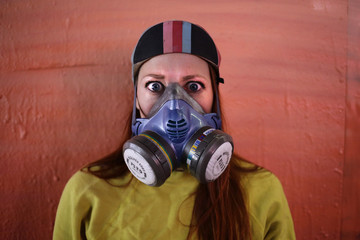 Polish-American artist Michelle Tylicki poses against a pink background during a graffiti art event in London