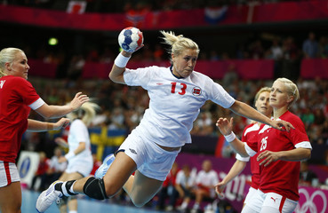 Norway's Marit Malm Frafjord takes a shot against Denmark in their women's handball Preliminaries Group B match at the Copper Box venue during the London 2012 Olympic Games