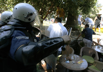 Police clash with anti-gay protestors during a gay pride parade in Budva