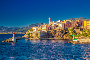 View to Bastia old city center, lighthouse and harbour, Corsica, France, Europe.