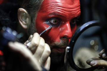 Markus Spiegel paints his face before a Perchten festival in the western Austrian village of Huben
