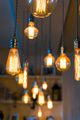 Photo burning lamps in retro style under the ceiling