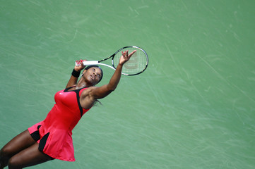 Serena Williams of the U.S. serves to Victoria Azarenka of Belarus during their match at the U.S. Open tennis tournament in New York
