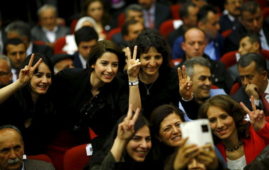 Female candidates of pro-Kurdish Peoples' Democracy Party pose for a selfie during a meeting, beginning their party's campaign for Turkey's June 7 parliamentary elections in Ankara