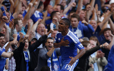 Malouda of Chelsea celebrates scoring his team's second goal against West Bromwich Albion during their English Premier League soccer match in London