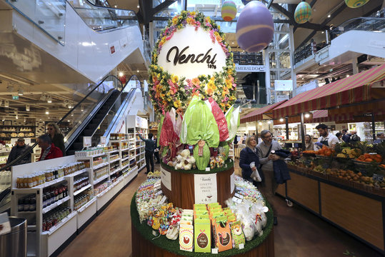 A chocolate Easter egg is displayed  at the Eataly food market store entrance in the former Smeraldo teather downtown Milan