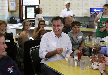 Republican U.S. presidential candidate Romney eats ice cream during a campaign stop at Tom's Ice Cream Bowl in Zanesville