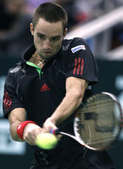 Serbia's Troicki hits a return against France's Chardy during their Kremlin Cup semifinal tennis match in Moscow