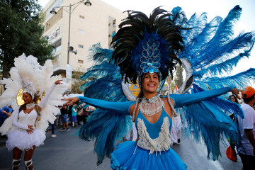 Israelis and foreign nationals participate in the Jerusalem March, an annual pro-Israel procession that takes place in the city during the Jewish holiday of Sukkot