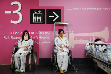 Women posing as patients take part in a drill in the Israeli city of Haifa