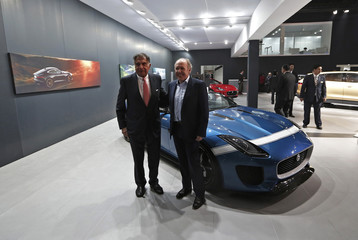Indian businessman Ratan Tata and Ian Callum, design director at Jaguar, stand next to the Jaguar Project 7 concept car during the Indian Auto Expo in Greater Noida