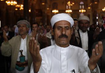 Supporters of Yemen's President Ali Abdullah Saleh take part in the weekly Friday prayers at al-Saleh mosque in Sanaa