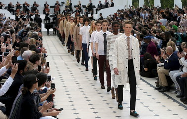 "Models present creations from the Burberry Spring/Summer 2015 collection during ""London Collections: Men"" in London"