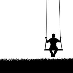 male silhouette on swing