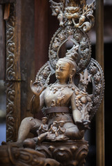 Ancient statue of a bodhisattva of Avalokiteshvara, made of bronze in nevara style, in the Golden Temple, Lalitpur, Kathmandu, Nepal.