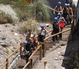 Tourists prepare to raft through the waters of the Rio Mendoza in the Potrerillos district of the Andean Argentine province of Mendoza