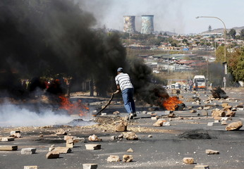 Protester sets tyres alight while protesting against what they called the unaffordable electricity prices, in Soweto
