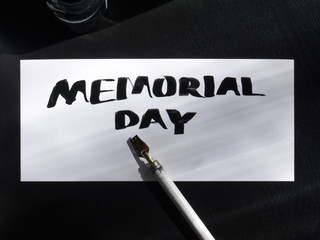 Memorial day calligraphy and lettering post card with wild pen. Top view.