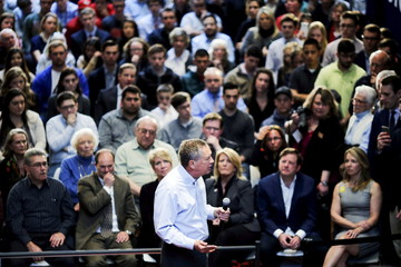 U.S. Republican presidential candidate Kasich speaks to guests during a town hall meeting in Fairfield, Connecticut