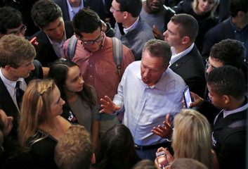 U.S. Republican presidential candidate John Kasich speaks with supporters during a campaign stop in Chicago
