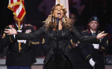 Mary J. Blige sings the American National Anthem at the start of the NBA All-Star game in Orlando