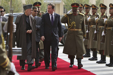 Afghanistan's President Hamid Karzai and Britain's Prime Minister David Cameron review an honour guard in Kabul