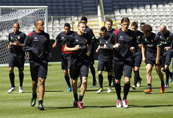 Belgium's national soccer players run during a training session at the King Baudouin stadium in Brussels