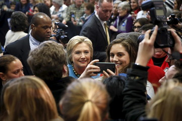 Democratic U.S. presidential candidate Hillary Clinton poses with a supporter during a campaign stop at Manchester Community College in Manchester, New Hampshire