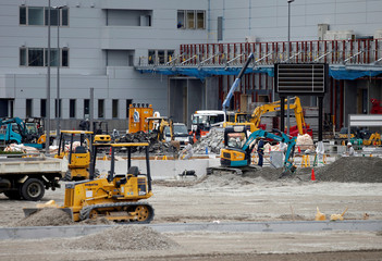 Workers are seen at new Tokyo Metropolitan Central Wholesale Market, known as Toyosu Market, which will take over from the famous Tsukiji market as early as next year, under construction in the Toyosu district in Tokyo