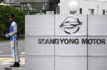 A security guard of Ssangyong Motor stands at the entrance of the automaker's main plant in Pyeongtaek