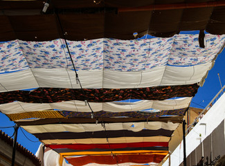 Detail from the roof made with Colorful cloths from a Islamic street market