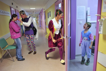 Member of Red Noses clown doctors perform in the paediatric clinic in Novo Mesto