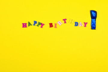 Yellow abstract background with the word  happy birthday