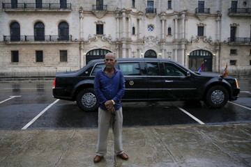 A member of security personnel guards the limousine of U.S. President Barack Obama as he tours Old Havana with his family at the start of a three-day visit to Cuba, in Havana