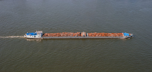 Waste disposal on cargo ship. Boat and scrap metal
