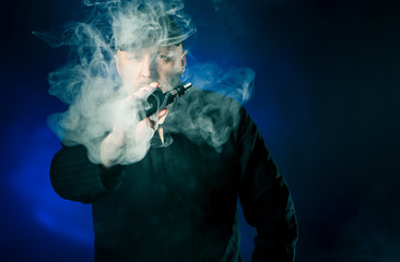 Electronic cigarette in hand.
